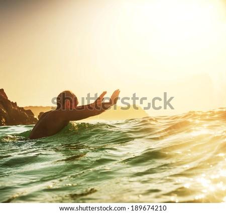 happy men in ocean - stock photo