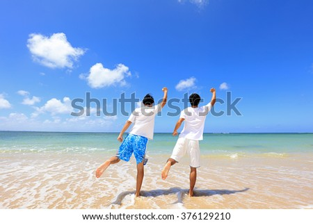 Happy men on a tropical beach
