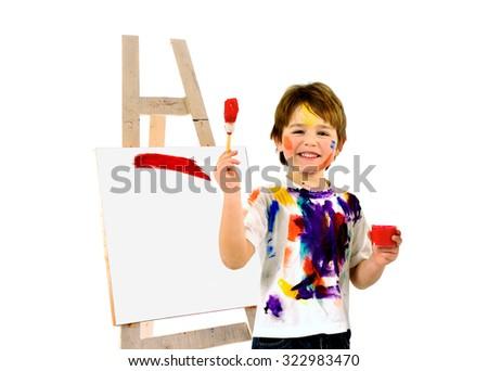 Happy messy little artist - stock photo
