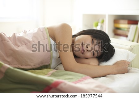 Happy Mid Adult Woman Waking Up - stock photo