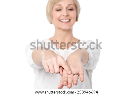 Happy mid woman showing her diamond ring - stock photo