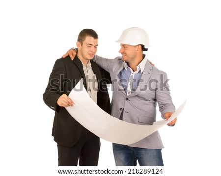 Happy Middle Age Engineers in Gray and Black Attire Holding Project Blueprint. Isolated on White Background. - stock photo