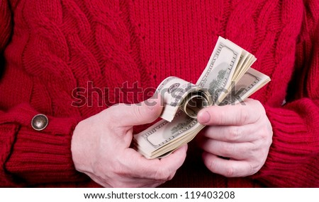 Happy middle age man with American money - stock photo