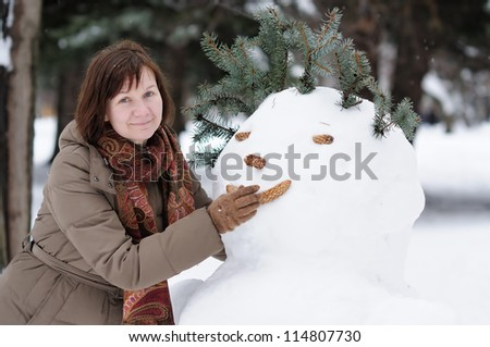 Happy middle age woman having fun in winter - stock photo