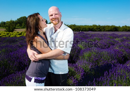 Happy middle aged couple in a field of purple lavender