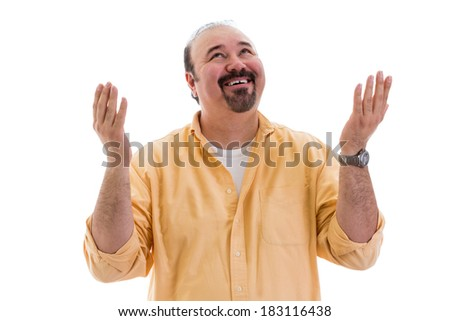 Happy middle-aged man giving thanks to God for a successful outcome smiling and raising his hands with a smile in thanksgiving, part of a series on body language, isolated on white - stock photo