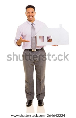 happy middle aged man presenting white paper house on white background - stock photo