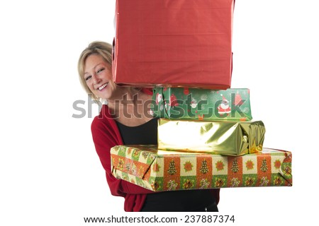 Happy middle aged woman holding a lot of presents against a white background