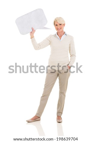 happy middle aged woman holding speech bubble on white background - stock photo