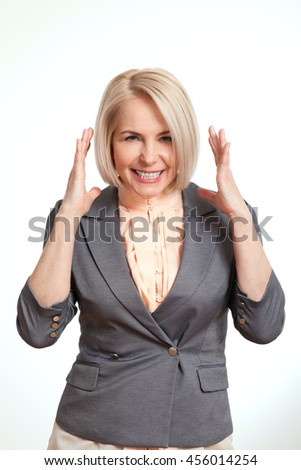 Happy middle-aged woman. Surprised woman isolated on white background. Human face expression, emotions, feeling attitude reaction - stock photo