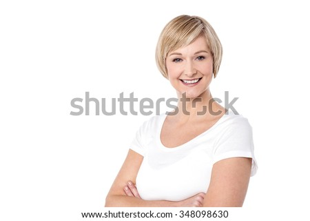 Happy middle aged woman with her arms crossed - stock photo