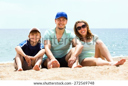Happy middle-class family with son  in vacation at seaside  - stock photo