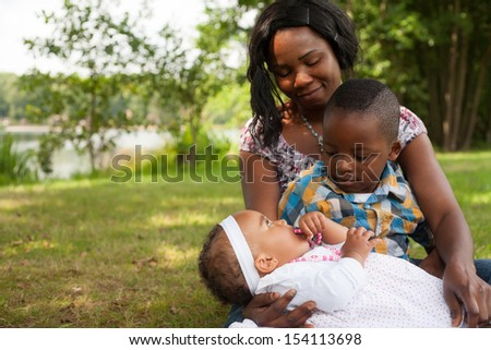 Happy mixed family is having a nice day in the park - stock photo