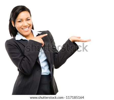 Happy mixed race business woman pointing at empty copy space isolated on white background - stock photo