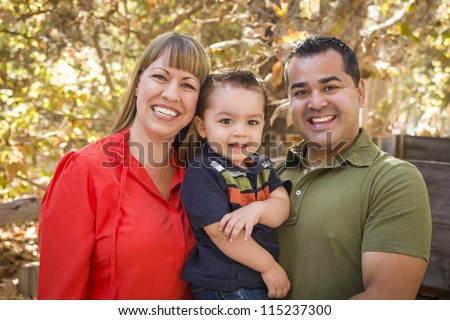 Happy Mixed Race Family Posing for A Portrait in the Park. - stock photo