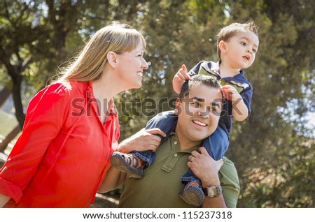 Happy Mixed Race Family with Enjoy a Walk in the Park. - stock photo