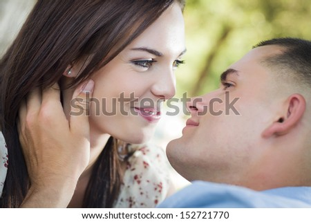 Happy Mixed Race Romantic Couple Portrait in the Park.