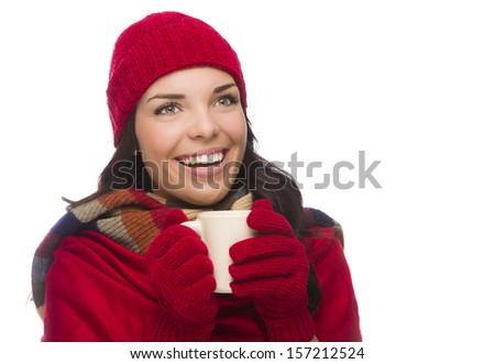 Happy Mixed Race Woman Wearing Winter Hat and Gloves Holds a Mug Isolated on White Background Looking to the Side.