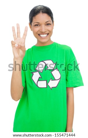 Happy model wearing recycling tshirt showing three fingers on white background - stock photo
