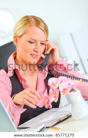 Happy modern business woman carefree talking phone in office