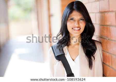 happy modern college girl on campus - stock photo