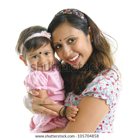 Happy modern Indian mother hugging her daughter isolated on white background - stock photo