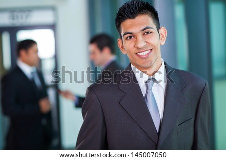 happy modern middle eastern businessman in office - stock photo