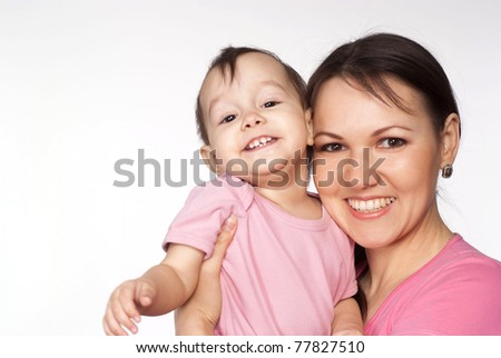 happy mom and a pretty baby on white