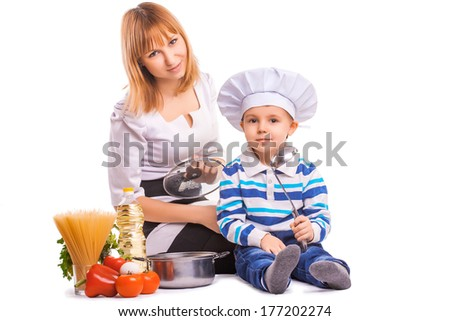 happy mom and baby are cooking on the kitchen