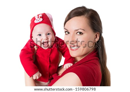Happy mom and baby girl hugging and laughing.The concept of childhood and family - stock photo