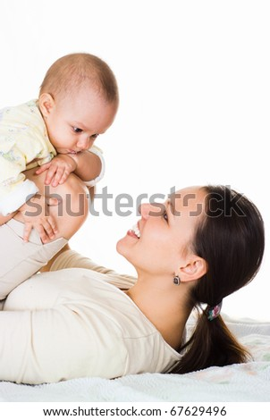 happy mom and baby on a light background