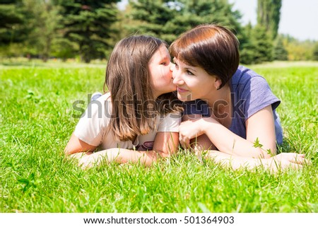 Happy mom and child girl hugging. The concept of childhood and family. Beautiful Mother and her baby outdoor