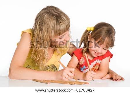 happy mom and daughter drawing at table