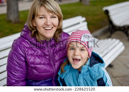 happy mom and daughter  (selective focus)