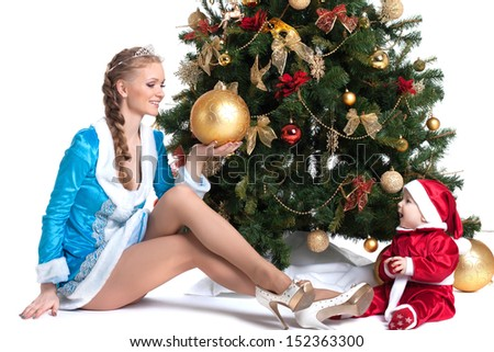 Happy mom and kid posing in Christmas costumes - stock photo