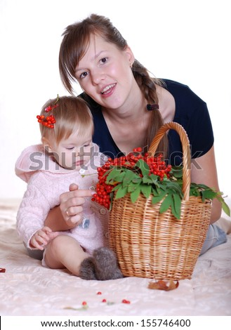 happy mom with a baby girl and a basket of ash