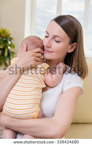 Happy mom with her baby - stock photo
