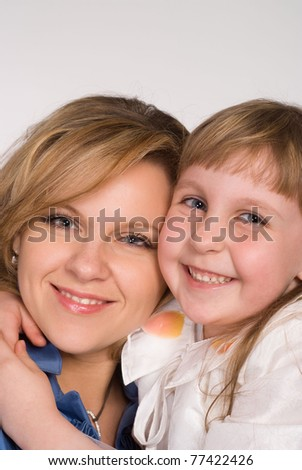 happy mom with her daughter on white background