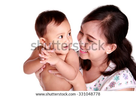 Happy moment between mom and her baby daughter, isolated on white background - stock photo