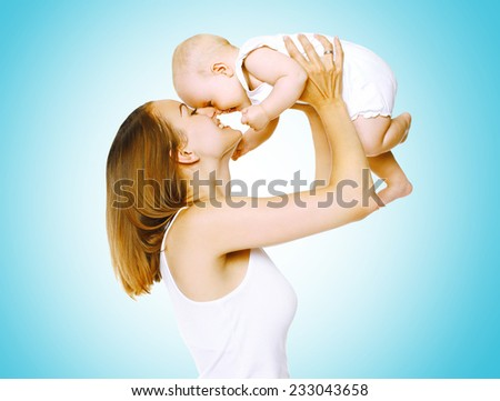 Happy moment, joyful mother and baby having fun together - stock photo