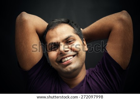 Happy moment of handsome indian man - stock photo