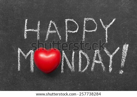 happy Monday exclamation handwritten on chalkboard with heart symbol instead of O
