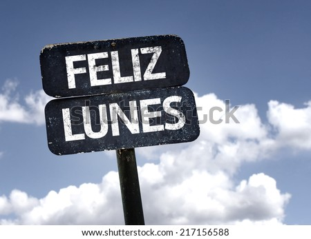 Happy Monday (In Spanish) sign with clouds and sky background - stock photo