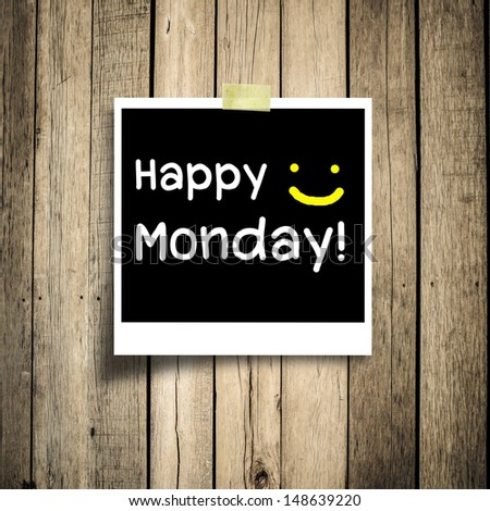 Happy Monday on grunge wooden background with copy space - stock photo