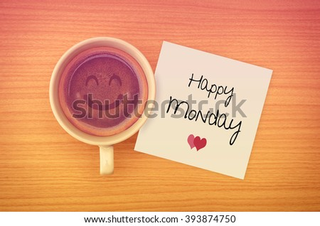 Happy Monday on paper note with coffee cup,top view. - stock photo