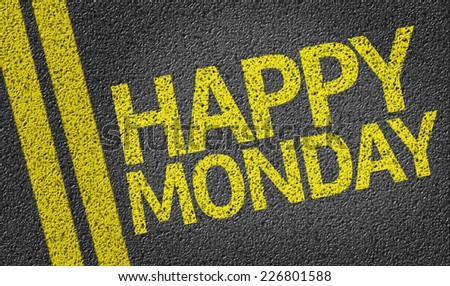 Happy Monday written on the road - stock photo