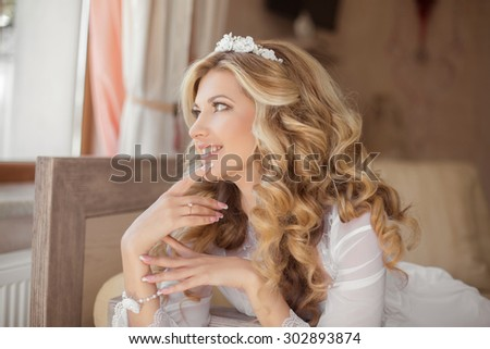 Happy Morning Portrait of beautiful smiling bride. Wedding hairstyle. Wedding decoration. - stock photo