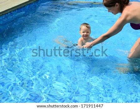 happy mother and baby in the swimming pool
