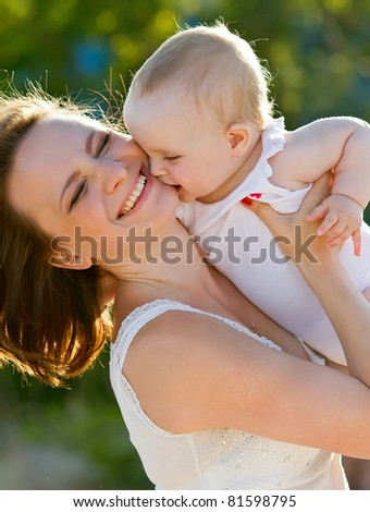 happy mother and baby playing - stock photo