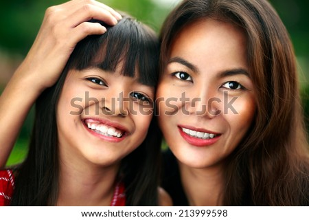 Happy mother and child girl, Cross processing color tone - stock photo